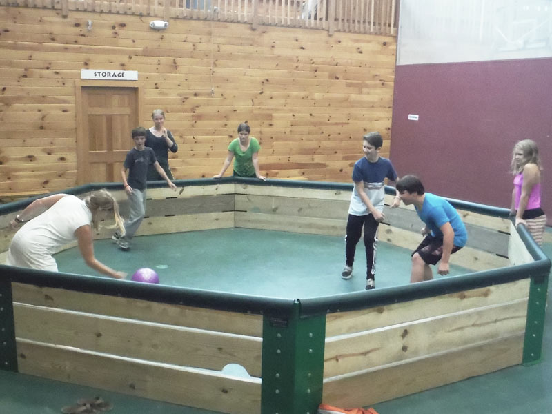 Here's the indoor playground at Camp Manitou, where we go during rainy days. These kids are playing a version of dodgeball where you can only hit the opponent's feet.