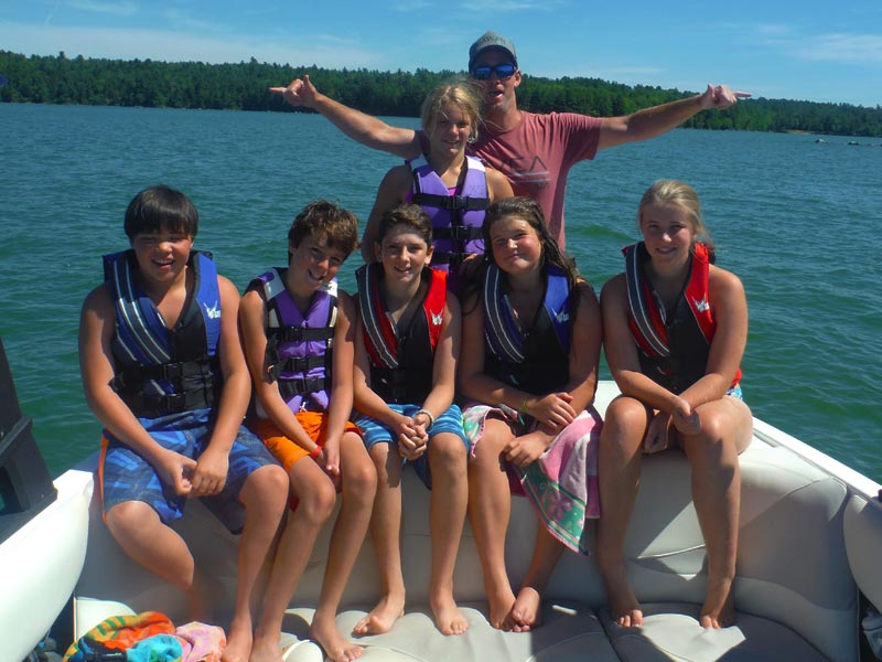 Here's the whole gang hanging out on the wake sports boat. This is from the final day of last year's camp - look at how much fun they're having, they don't want to leave!
