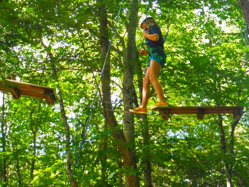 One of the usual activities is the aerial ropes course at Camp Manitou in the Belgrade Lakes of Maine. Mud City and Manitou team up every summer for kids adventure camp.