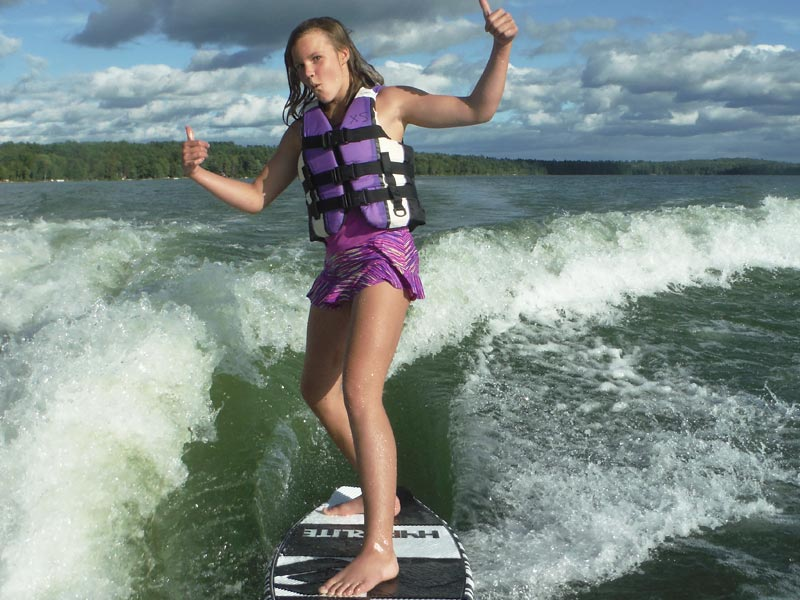 Here's another one of our campers getting rad while wake surfing behind the boat. It's completely safe and we have professional instructors.