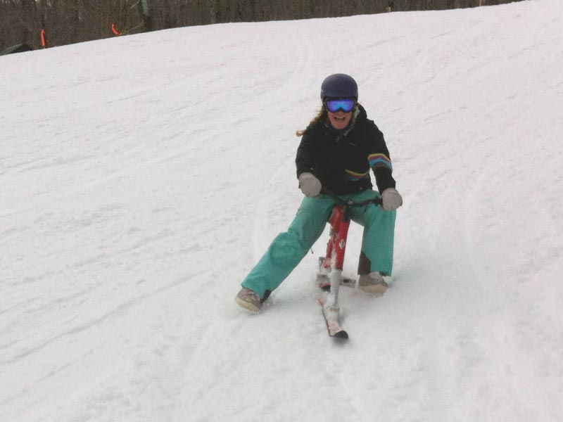 Christine from Mud City Adventures ripping it up on a ski bike at Jay Peak!