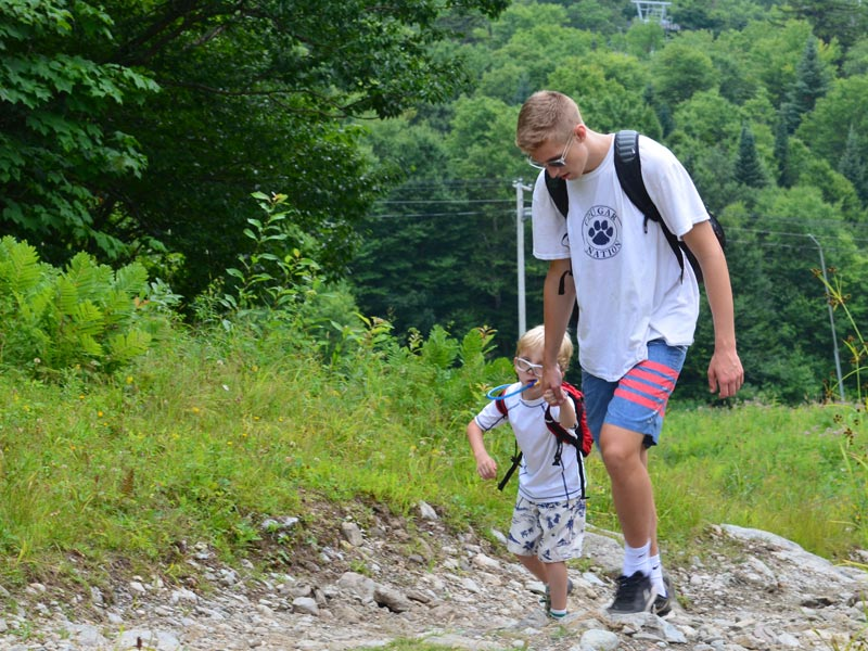 Here's a younger camper and his hiking buddy making their way up the mountain. All of the kids are under constant adult supervision.