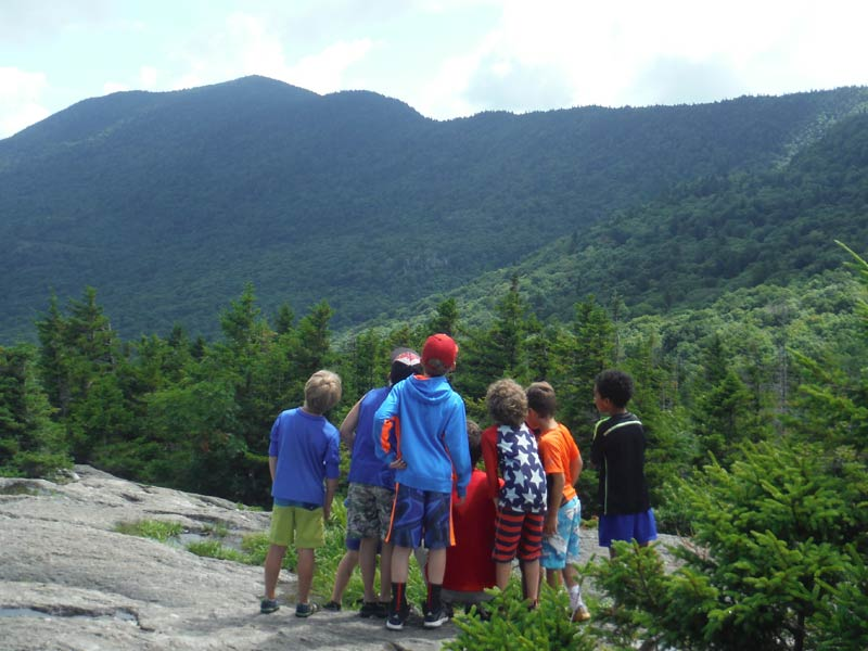 At this Stowe and Waterbury Vermont based summer day camp for kids, we are all about outdoor adventure and recreation. Here are some campers atop Spruce Peak overlooking Mount Mansfield.