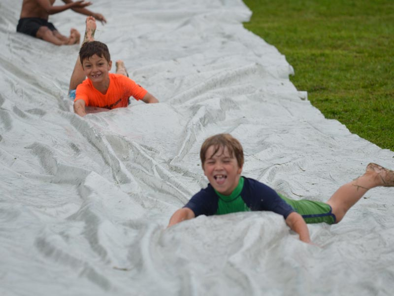 Here are some day campers having a wicked time on the slip'n'slide. Call or email Mud City Adventures for kids' day camp near the Stowe, Waterbury, Morrisville, Waitsfield, and Warren Vermont areas.