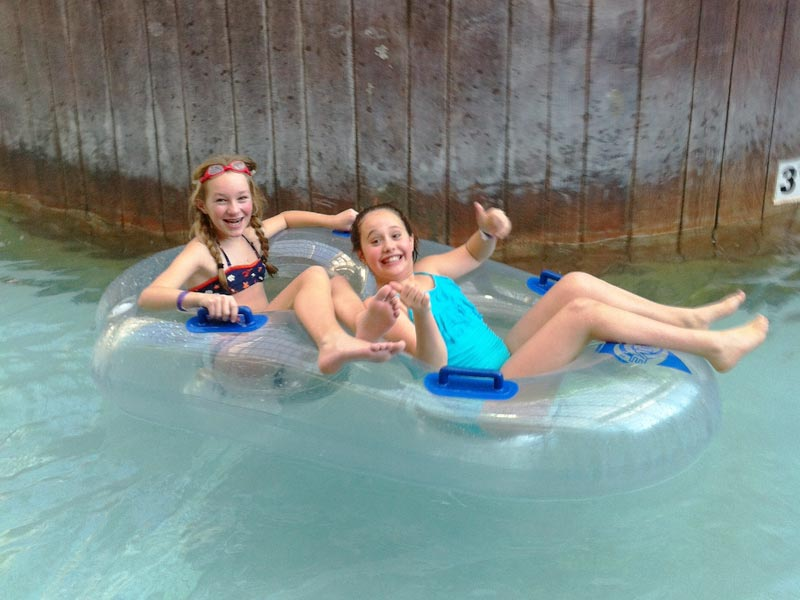 Being lazy in the lazy river at the Jay Peak Water Park with the Mud City Adventures crew from Stowe