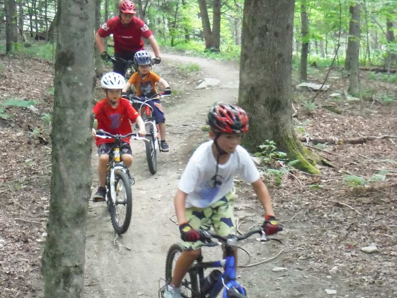 Our expert mountain bike instructors follow the campers down the trails in Stowe Vermont. Our mountain bike camp for kids also services the Waterbury, Waitsfield, Warren, Richmond, Morrisville, and Jeffersonville areas.