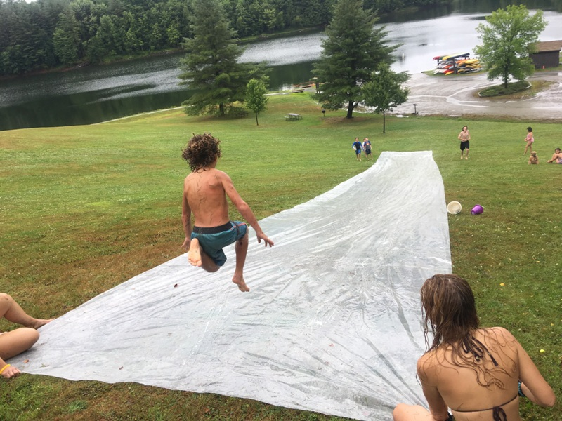 This little camper is having fun splashing around Mud City style. We're the top outdoor day camp for kids in the Waterbury and Stowe area, give us a call.