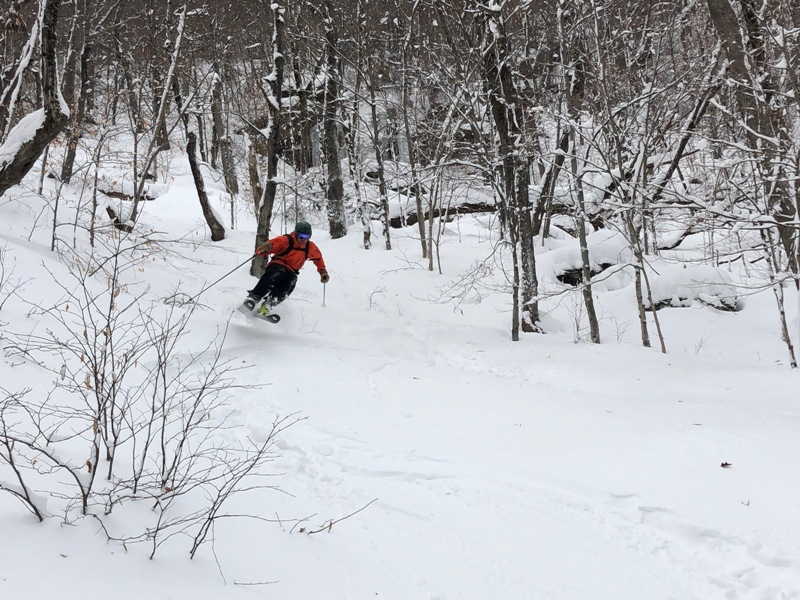 Sometimes it's necessary to take breaks while back country skiing in Stowe. Here is Christine on the ascent of a local's back country skiing spot in Stowe, Vermont.