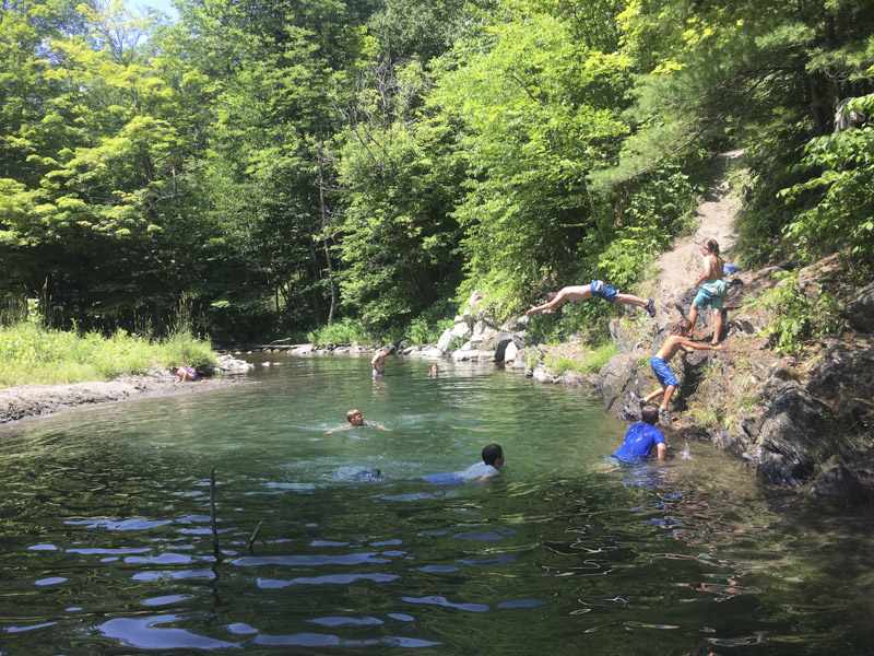 This camper is embracing the Mud City lifestyle 100%. Here is one of our Stowe VT campers jumping into the river off of a small rock.
