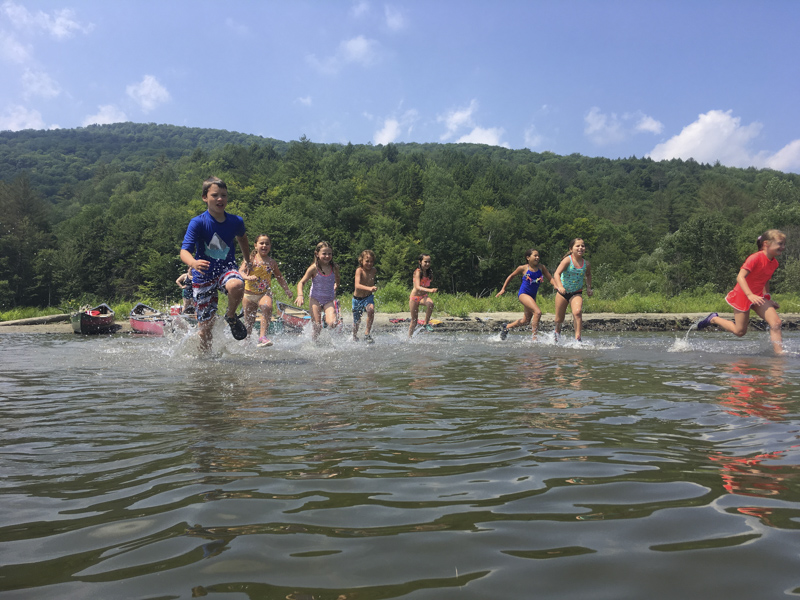 Here are a few campers having fun at the beach with bubbles. Mud City Adventures, based in Stowe, Vermont, operates a day camp program for kids.