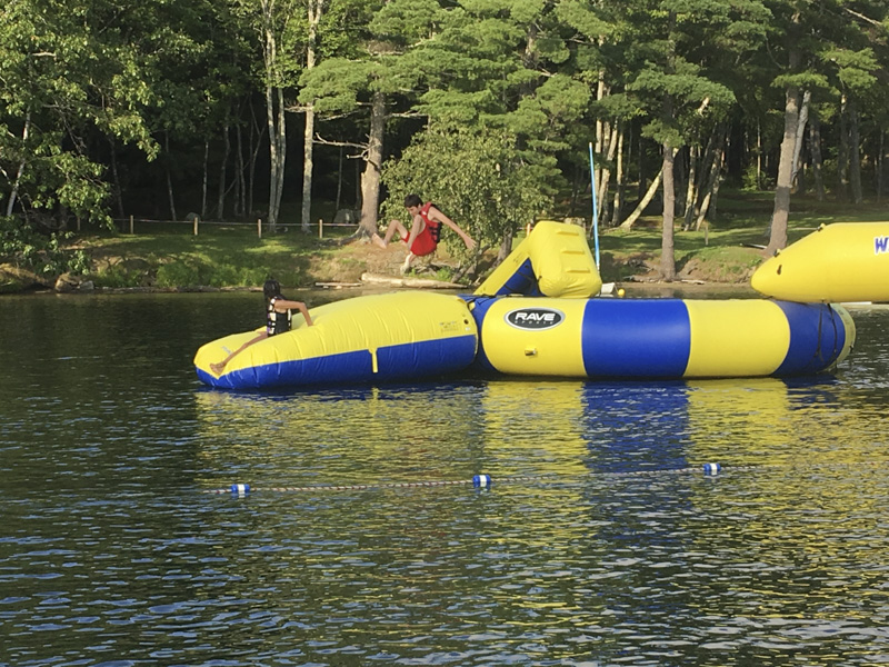 Mud City Summer Camp for Kids, based in Stowe VT, hits the trail for Belgrade Lakes in Maine. Camp Manitou has a blob, as well as many other water toys for kids. Water trampoline too!