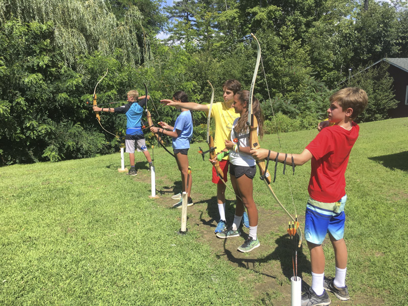 In between wake surfing and wakeboarding sessions, we like to teach the kids a variety of skills and play a bunch of different team building games. Here are some kids honing their archery skills during free time.